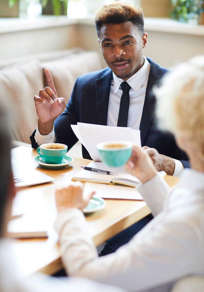 business-meeting-during-a-coffee-break-93AH7TK.jpg